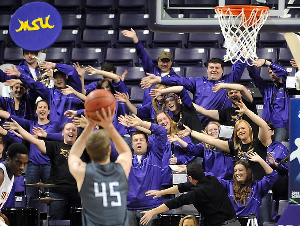 The Minnesota State pep band tries to distract Northwest Missouri State's Grant Cozad during the first half of the NCAA Division II Central Region semifinal game Sunday at Bresnan Arena. Pat Christman
