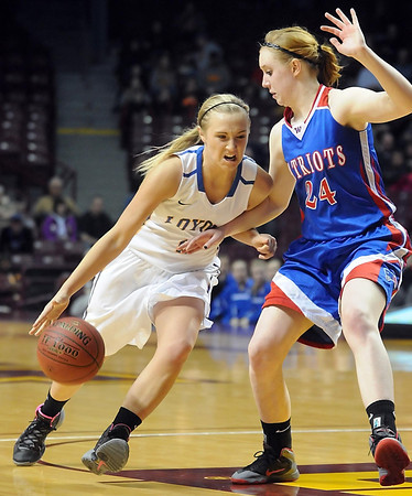 Mankato Loyola's Megan Schroeder tries to get past Win-E-Mac's Shelby Kaster during the second half of the Class A semifinal game Thursday at Williams Arena. Pat Christman