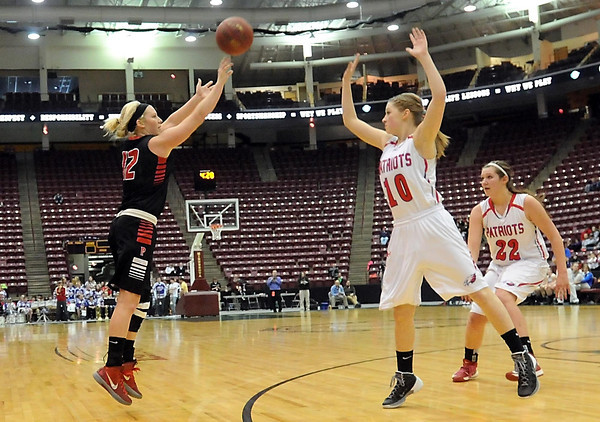 NRHEG's Jade Schultz shoots over Pequot Lakes' Kelsey Hart during the second half of the Class AA quarterfinal game Wednesday at Mariucci Arena. Pat Christman