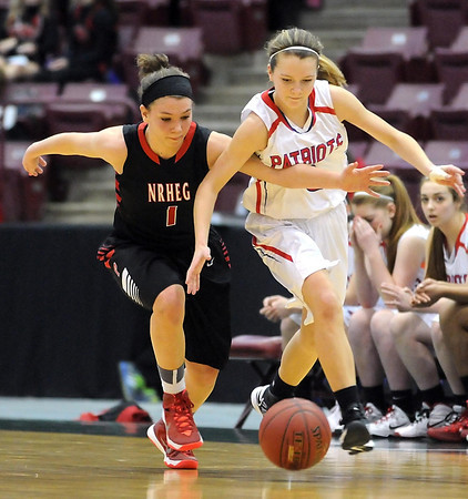 NRHEG's Maddie Wagner pokes the ball away from Pequot Lakes' Haley Wiebolt during the second half of the Class AA quarterfinal game Wednesday at Mariucci Arena. Pat Christman