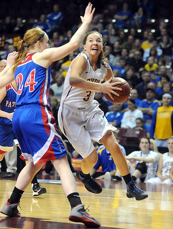 Mankato Loyola's Lindsey Theuninck takes to the air to get around Win-E-Mac's Shelby Kaster during the second half of the Class A semifinal game Thursday at Williams Arena. Pat Christman