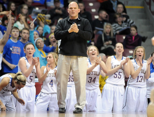 Loyola coach Rick Theuninck watches his team during the first half of the Class A semifinal game Thursday at Williams Arena. Pat Christman