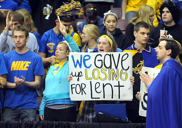 A Loyola fan holds up a sign during the Class A semifinal game Thursday at Williams Arena. Pat Christman