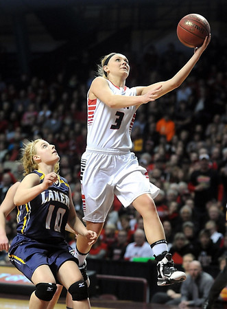 NRHEG's Carlie Wagner makes a layup to eclipse the record for most points scored in the state tournament formerly held by Janet Karvonen during the second half of the Class AA semifinal game against Howard Lake-Waverly-Winsted Thursday at Williams Arena. Pat Christman