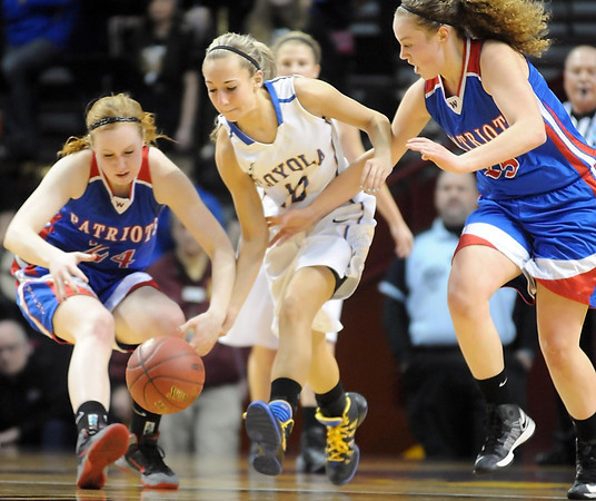 Loyola's Jordyn Strachan is surrounded by Win-E-Mac's Shelby Kaster (24) and Alayna Espeseth (25) as they scramble for a loose ball during the first half of the Class A semifinal game Thursday at Williams Arena. Pat Christman