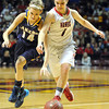 NRHEG's Maddie Wagner (1) and Howard Lake-Waverly-Winsted's Taylor Smida (14) race for a loose ball during the second half of the Class AA semifinal game Thursday at Williams Arena. Pat Christman