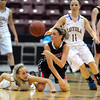 Maranatha Christian's Lexi Lee passes the ball away from Loyola's Jordyn Strachan, left, and Aunikah Bastian during the first half of the Class A quarterfinal game Thursday at Mariucci Arena. Pat Christman
