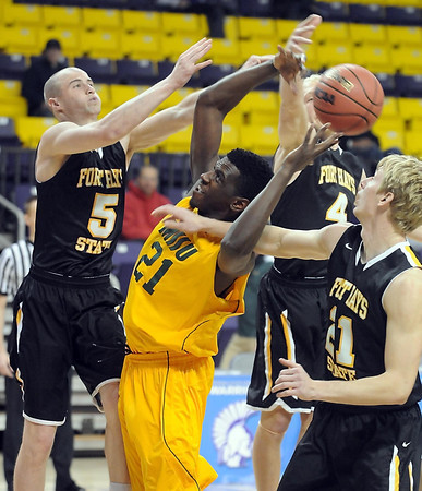 Missouri Southern State's Jordan Talbert is surrounded by Fort Hays State defenders as he reaches for a rebound during the first half of a NCAA Division II Central Region basketball game Saturday at Bresnan Arena in Mankato, Minn. Photo by Pat Christman