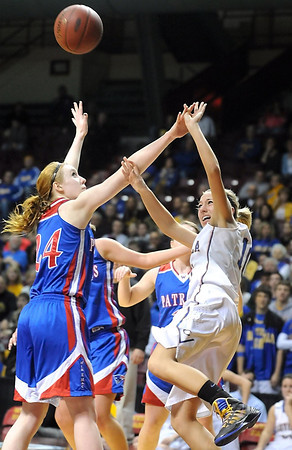 Loyola's Jordan Strachan puts up a shot as Win-E-Mac's Shelby Kaster defends her during the second half of the Class A semifinal game Thursday at Williams Arena. Pat Christman