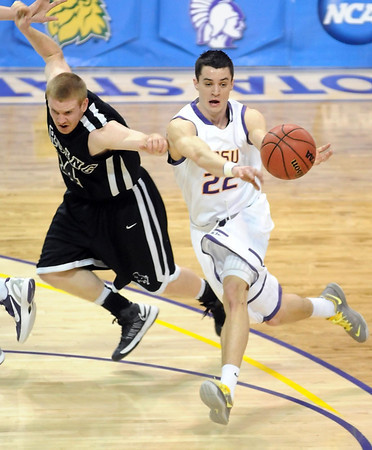 Minnesota State's Zach Monaghan passes the ball away from Harding's Weston Jameson during the first half of the NCAA Division II Central Region tournament game Saturday at Bresnan Arena. Pat Christman