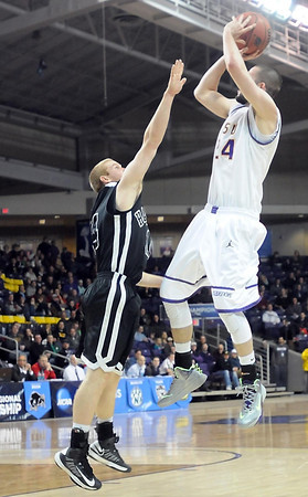 Minnesota State's Tanner Adler shoots against Harding during the first half of the NCAA Division II Central Region tournament game Saturday at Bresnan Arena. Pat Christman
