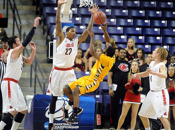 Arkansas Tech's Clarence Willard falls as he shoots against Central Missouri Saturday at Bresnan Arena. Pat Christman