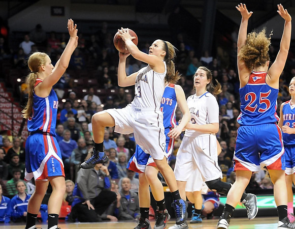 Mankato Loyola's Lindsey Theuninck splits a pair of Win-E-Mac defenders during the first half of the Class A semifinal game Thursday at Williams Arena. Pat Christman