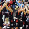 NRHEG's Carlie Wagner, left, and Jade Schultz are congratulated as they come out of the game during the second half of the Class AA quarterfinal game Wednesday at Mariucci Arena. Pat Christman