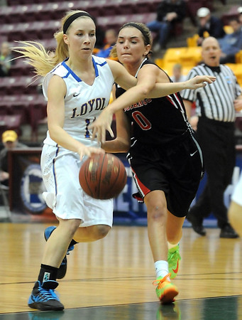Maranatha Christian Academy's Lexi Lee fouls Loyola's Aunikah Bastian during the first half of the Class A quarterfinal game Thursday at Mariucci Arena. Pat Christman