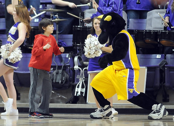 A young fan dances with Stomper during the first half Sunday. Pat Christman