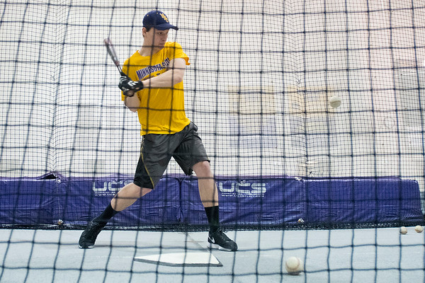 Minnesota State's Hunter Frericks takes batting practice on Thursday. Frericks is a red shirt freshman on the MSU baseball team. Photo by Jackson Forderer