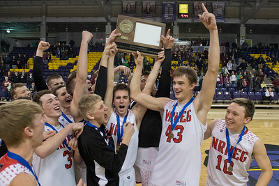 The New Richland-Hartland-Ellendale-Geneva boys basketball team celebrates with their newly awarded Section 2AA championship trophy after winning a nail-biter game against Jordan. Tyler Raimann (43) led the Panthers in scoring to help NRHEG edge Jordan 65-64. Photo by Jackson Forderer