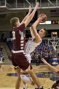 New Richland-Hartland-Ellendale-Geneva's Oakley Baker goes up for a shot against Jordan's Jimmy Vollbrecht (31) in the second half of the Section 2AA championship game. Photo by Jackson Forderer