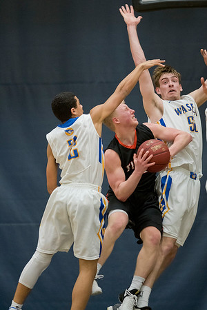 Waseca's Jake Guse, right, and Malik Willingham (2) try to prevent Marshall's Zach Bloemker from scoring in the second half of Thursday's Section 2AAA championship game. Marshall defeated Waseca 57-43 and advanced to the state tournament. Photo by Jackson Forderer