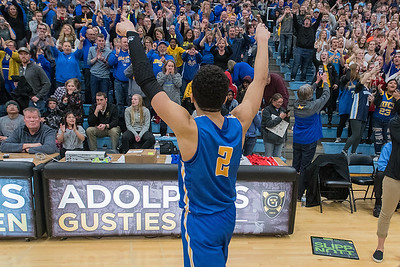 Malik Willingham of Waseca goes over to celebrate with the crowd after the Bluejays, ranked #2 in the state, beat #3 Mankato East to head to the state boys basketball tournament. Photo by Jackson Forderer