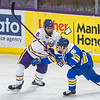 Minnesota State's Connor Mackey checks Lake Superior State's Jacob Nordqvist off of the puck in the second period of Saturday's game. MSU won the game 2-0 to move on to the championship round of the WCHA conference tournament. Photo by Jackson Forderer