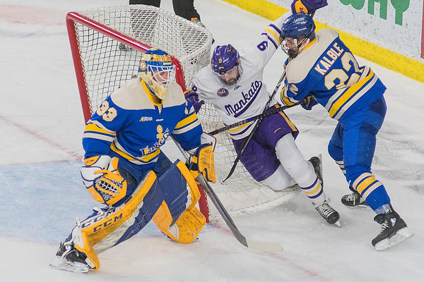 Lake Superior State's Lukas Kaelble pushes Minnesota State's Charlie Gerard into the net after a break away chance for Gerard. Photo by Jackson Forderer