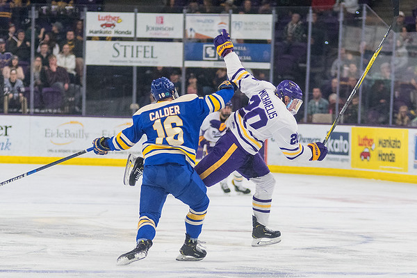 Minnesota State's Marc Michaelis flies through the air after being hit by Ashton Calder of Lake Superior State in the second period of Saturday's game. The Mavericks closed out the series by winning 2-0 and will face Bowling Green in the championship round. Photo by Jackson Forderer
