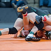 Tanner Pasvogel of Sibley East wrestles against Tanner Reetz of Frazee in the championship match of the Class A 132-pound weight class at the Xcel Energy Center. Pasvogel defeated the unbeaten Reetz to claim the championship. Photo by Jackson Forderer