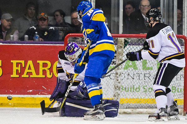 Jason Pawloski of Minnesota State makes a blocker save against Alaska's John Mullally (18) in Friday's game played at the Verizon Wireless Center. Pawlowski shutout the Nanooks on Friday. Photo by Jackson Forderer