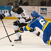 C.J. Franklin (15) of Minnesota State tips the puck past Alaska's diving Zach Frye (6) in the third period. MSU won the first game of the best of three series 3-0 Friday night at the Verizon Wireless Center. Photo by Jackson Forderer