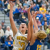 Mankato East's Torey Richards (10) goes up for a shot over Waseca's Hannah Potter (12) in the first half of the Section 2AAA quarterfinal game played at Waseca on Tuesday. East lost to Waseca to 55-41 to end their season. Photo by Jackson Forderer