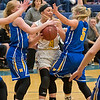 Mankato East's Natalie Schisel (4) gets trapped by two Waseca defenders including Taylor Hiller (5) in Tuesday's Section 3AAA quarterfinal game played in Waseca. The Cougars lost to the Bluejays 55-41. Photo by Jackson Forderer
