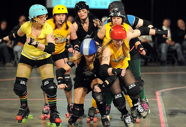 Nauty-Nelly (Janell Meyer) and Goosetown Roller Girls jammer Pit Bull Molly (red helmet) collide during their bout Saturday.