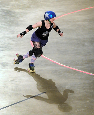 Mankato Area Derby Girls jammer Jaded By Design (Sara Anderson) races around the track during the team's first home roller derby bout Saturday at the Verizon Wireless Center.