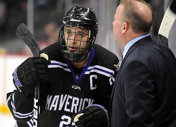 Minnesota State's Eriah Hayes talks with coach Mike Hastings during a time out in the third period Thursday at the Xcel Energy Center in St. Paul.