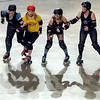 Goosetown Roller Girls jammer Bunzilla (in yellow) slips between a trio of Mankato Area Derby Girls blockers during their bout Saturday at the Verizon Wireless Center.