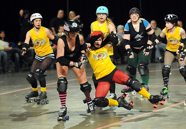 The Mankato Area Derby Girls' Nurse Nutcase (Brittany Schlie, left) hits New Ulm's Goosetown Roller Girls' Curly Temper during the MAD Girls' first home roller derby bout Saturday at the Verizon Wireless Center.