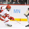 Minnesota State's Josh Nelson chases Wisconsin's Jefferson Dahl as he shoots at goalie Phil Cook during the third period of their WCHA Final Five game Thursday at the Xcel Energy Center in St. Paul.