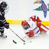 Wisconsin's Jefferson Dahl falls while hitting the puck away from Minnesota State's Josh Nelson during the first period of their WCHA Final Five game Thursday at the Xcel Energy Center in St. Paul.