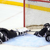 Minnesota State goalie Stephon Williams lays on the ice after being hurt during the second period of their WCHA Final Five game against Wisconsin Thursday at the Xcel Energy Center in St. Paul.