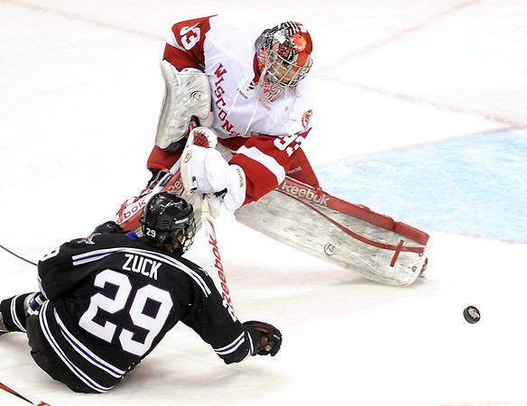 Wisconsin goalie Joel Rumpel swats the puck away from Minnesota State's Eli Zuck during the first period of their WCHA Final Five game Thursday at the Xcel Energy Center in St. Paul.