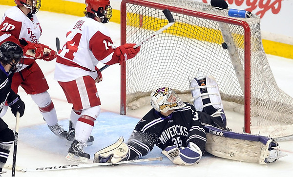 Wisconsin's Jefferson Dahl shoots the puck over Minnesota State goalie Stephon Williams during the second period of their WCHA Final Five game Thursday at the Xcel Energy Center in St. Paul.during the second period of their WCHA Final Five game Thursday at the Xcel Energy Center in St. Paul.