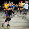 Mankato Area Derby Girls jammer Jaded By Design (Sara Anderson) scores points as she slips past the pack during the team's first home roller derby bout Saturday at the Verizon Wireless Center.