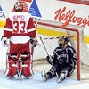 Minnesota State's Eriah Hayes looks up at Wisconsin goalie Joel Rumpel after ending up in the net with a Wisconsin player's broken stick during the first period of their WCHA Final Five game Thursday at the Xcel Energy Center in St. Paul.