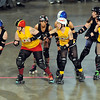 Mankato Area Derby Girls jammer Strawberry StrikeHer (Heather Voges) slips past a row of Goosetown Roller Girls blockers during a bout Saturday at the Verizon Wireless Center.