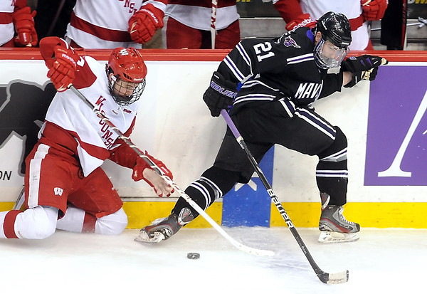 Wisconsin's Nic Kerdiles and Minnesota State's Chase Grant battle for the puck during the first period of their WCHA Final Five game Thursday at the Xcel Energy Center in St. Paul.