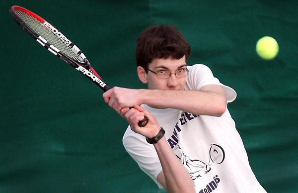 St. Peter's Matthew Huber returns a shot during a doubles match Saturday at the Swanson Tennis Center in St. Peter. Pat Christman