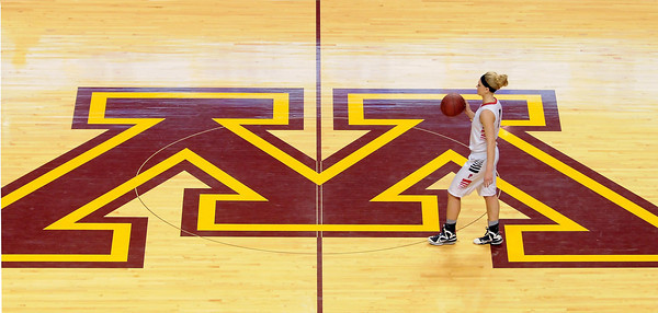 NRHEG guard and Minnesota Gopher recruit Carlie Wagner brings the ball up the court during the first half of the Class AA state championship game Saturday at Williams Arena. Photo by Pat Christman