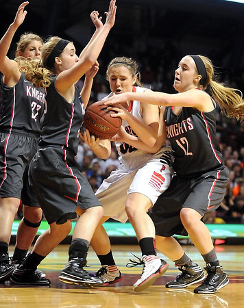 NRHEG's Hannah Lundberg is surrounded by Kenyon-Wanamingo defenders during the first half of the Class AA state championship game Saturday at Williams Arena. Photo by Pat Christman